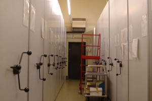 Aisle in archive strongroom with rolling racks
