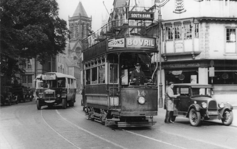 A 1930s bus, tram and motor car