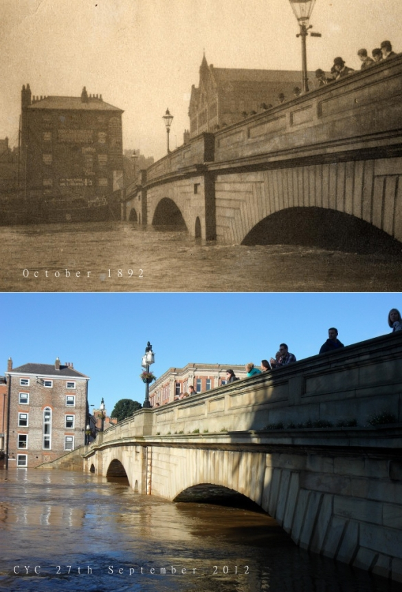Ouse bridge in flood with people looking on
