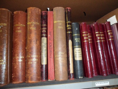Minute books on shelves