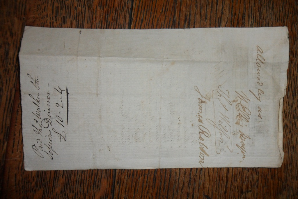 The reverse of the invoice, with authorisation on one end, and Chamberlain's note on the other.