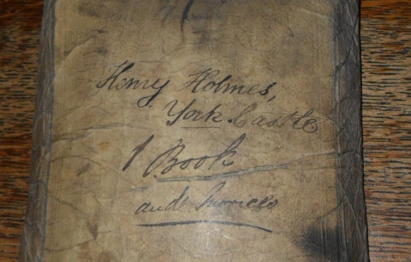 The label added by the court - Henry Holmes' case was at the Castle, not the Guildhall