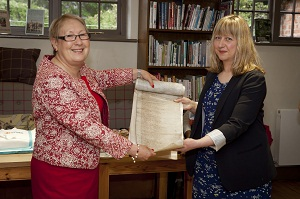 The oldest civic archive, the husgabel roll from the 1280s was ceremonially handed over by Cllr Sonia Crisp to the Explore Staff director, Vicky Pierce.