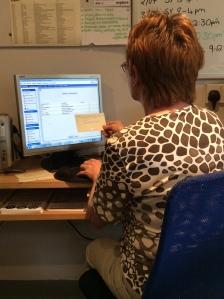 Volunteer working at computer.