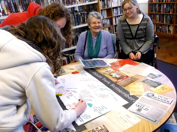 A grandmother, daughter and grandchildren share York memories with Explore staff and volunteers and Tang Hall Library