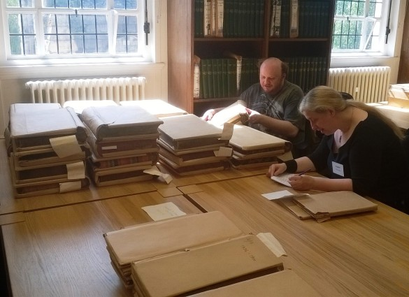 Some of our volunteers working hard cataloguing some of the community collections.