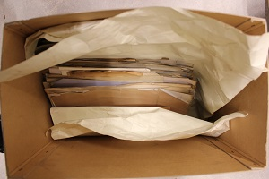 Paper files stored vertically causing bowing and damage to files